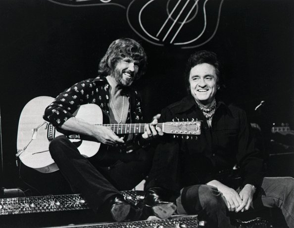 """Kris Kristofferson and Johnny Cash perform a duet on """"The Johnny Cash Show"""" in 1976. 