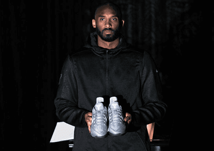Kobe Bryant posing with his Kobe A.D. sneakers event for their release at MAMA Gallery on November 1, 2016, in Los Angeles, California | Source: Allen Berezovsky/Getty Images