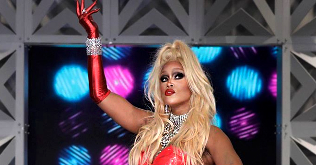 Eve Dressed up as RuPaul in Red Bodysuit with Tutu Skirt & Thigh-High Boots for 'The Talk's Halloween Episode