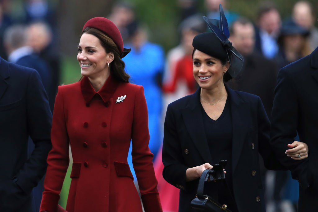 Catherine, Duchess of Cambridge and Meghan, Duchess of Sussex arrive to attend Christmas Day Church service at Church of St Mary Magdalene on the Sandringham estate. | Photo: Getty Images