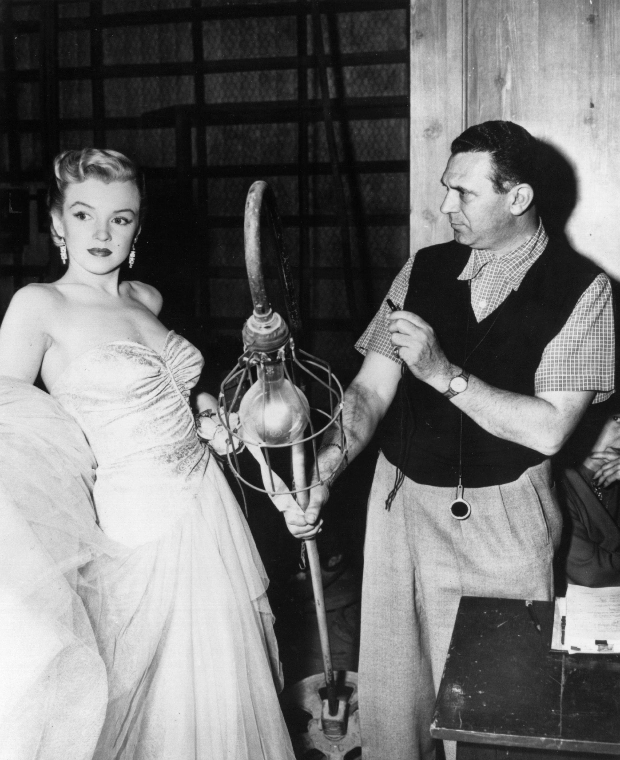 A technician checks the lighting for Marilyn Monroe during a rehearsal for her role in 'All About Eve'   Photo: Getty Images