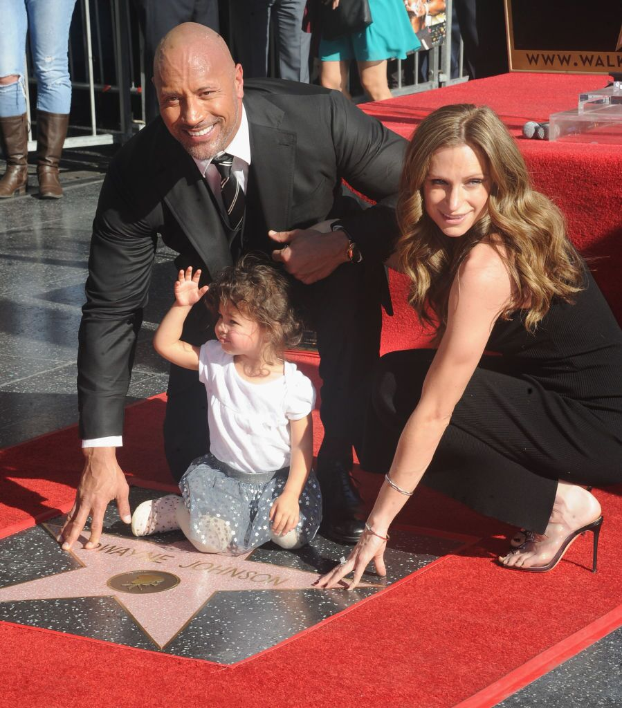 """Dwayne """"The Rock"""" Johnson accepting his Hollywood Walk of Fame star with then-girlfriend Lauren Hashian 