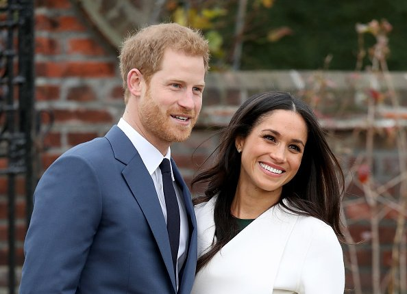 Prince Harry et l'actrice Meghan Markle lors d'un photocall | Photo: Getty Images