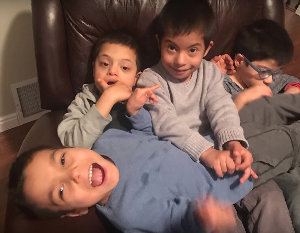 Simon and his three adoptive brothers l Source: Youtube/Carters Clips