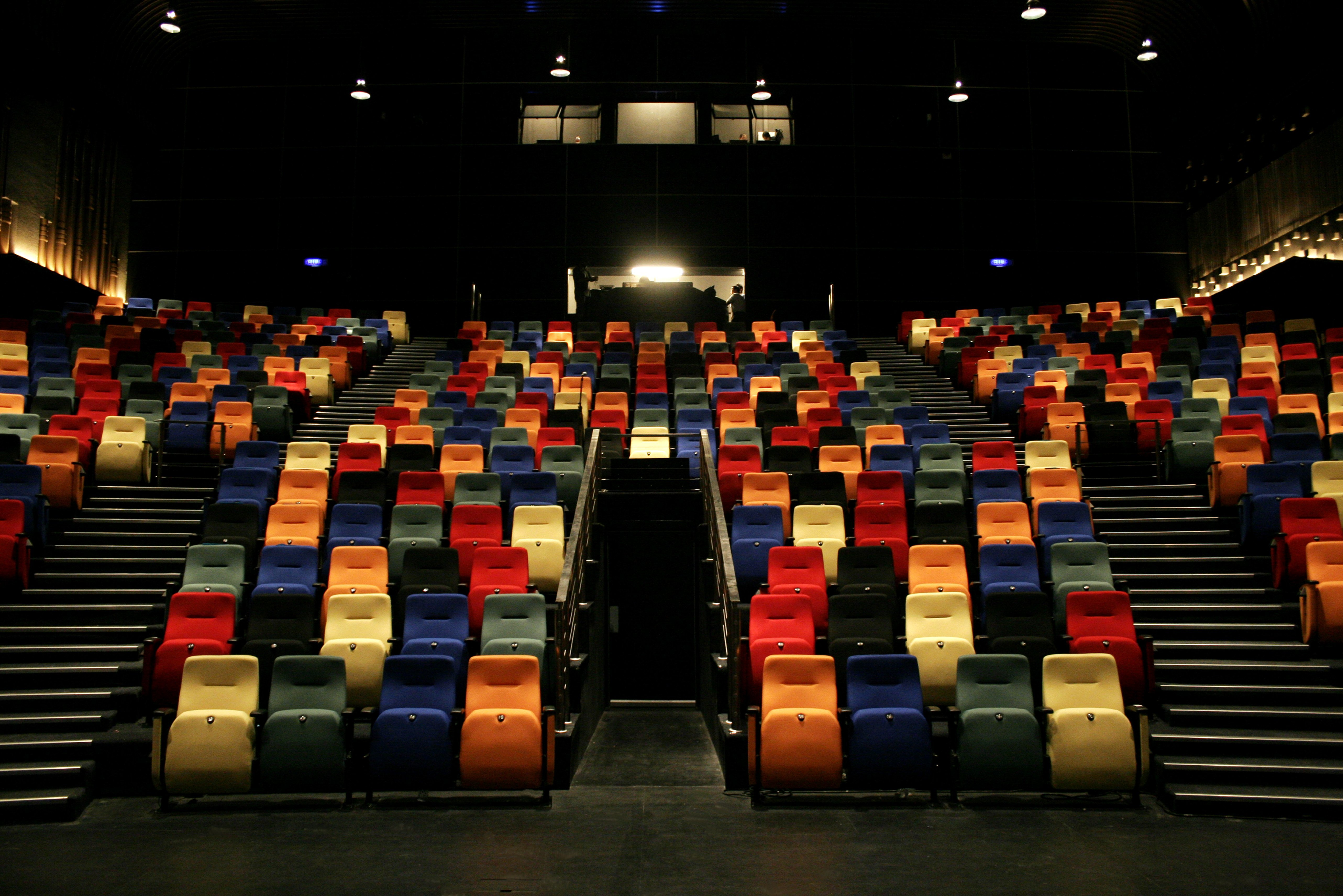 View of multicolored seats in the darkened auditorium of the new Kuala Lumpur Performing Arts Centre | Photo: Getty Images