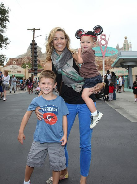 Sheryl Crow and her sons, Wyatt and Levi at Cars Land in Disney California Adventure park on July 25, 2012 in Anaheim, California. | Photo: Getty Images