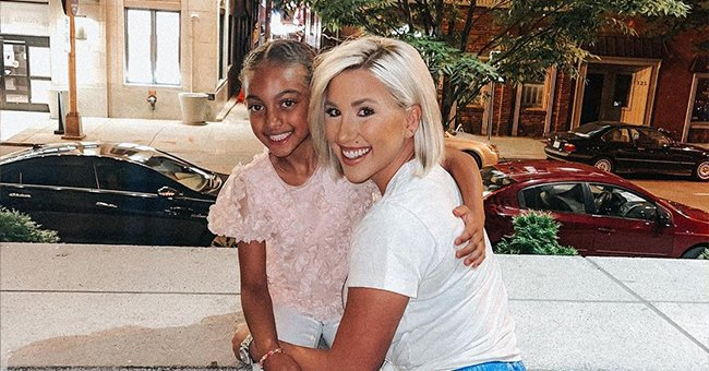 Savannah Chrisley Poses in a White T-Shirt & Blue Skirt with Biracial Niece Chloé in a Cute Pic