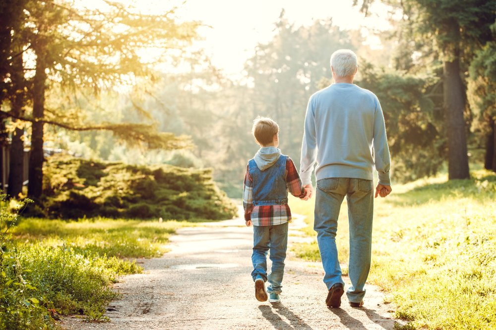 A photo of a boy taking a walk with his grandfather   Photo: Shutterstock
