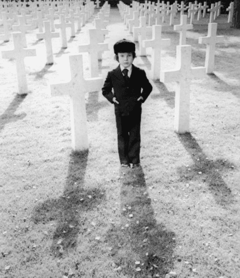 """Harvey Stephens stands in a cemetery of cross-shaped tombstones in a promotional still from the 1976 film, """"The Omen.""""   Photo: Getty Images"""