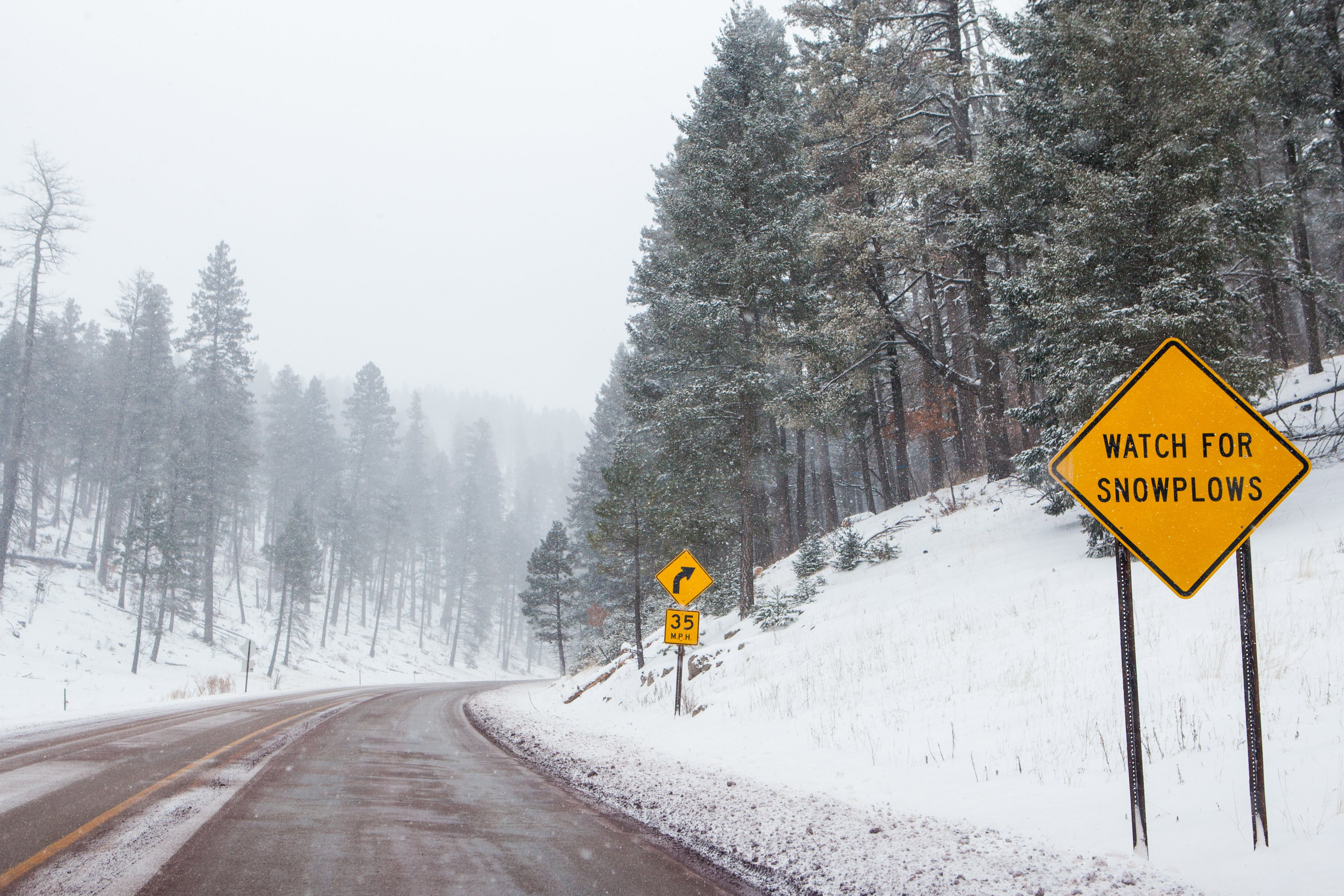 Pictured - A snowy mountain road with warning signs in Cloudcroft, New Mexico | Photo: Shutterstock