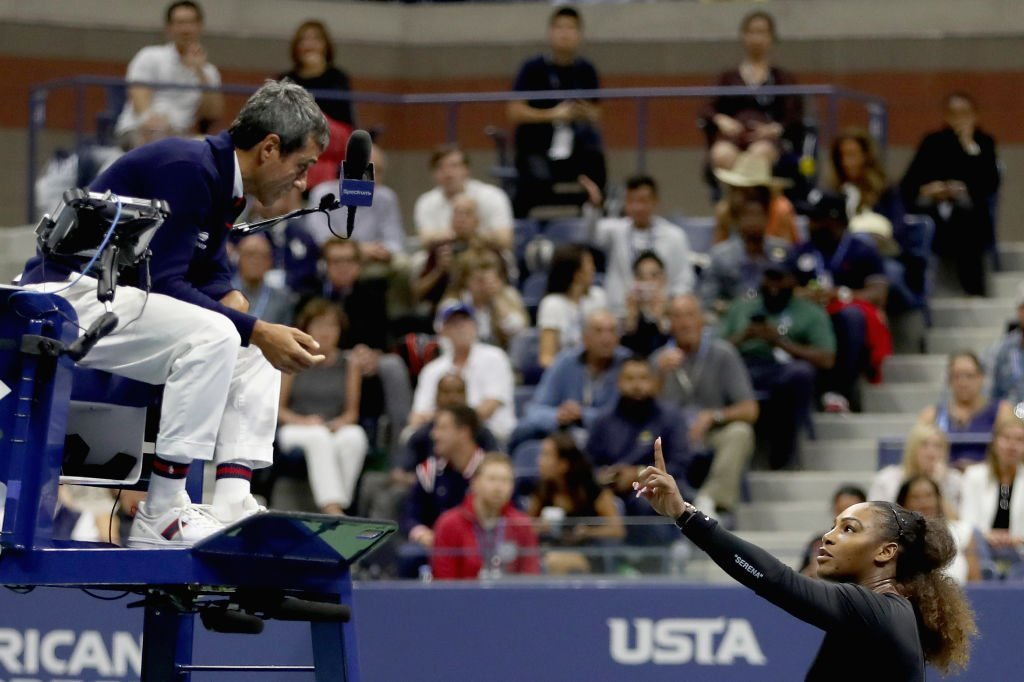Serena Williams reacts to umpire Carlos Ramos after her defeat in the Women's Singles finals match to Naomi Osaka at the 2018 US Open | Photo: Getty Images
