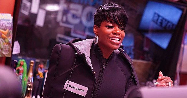 Fantasia's Grown Daughter Zion Flaunts Long Hair, Posing in All-Black Outfit near Fireplace