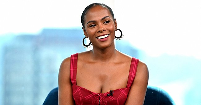 Tika Sumpter of 'Mixed-ish' Looks Simply Gorgeous with Double Hair Buns and Red Lips in a Photo