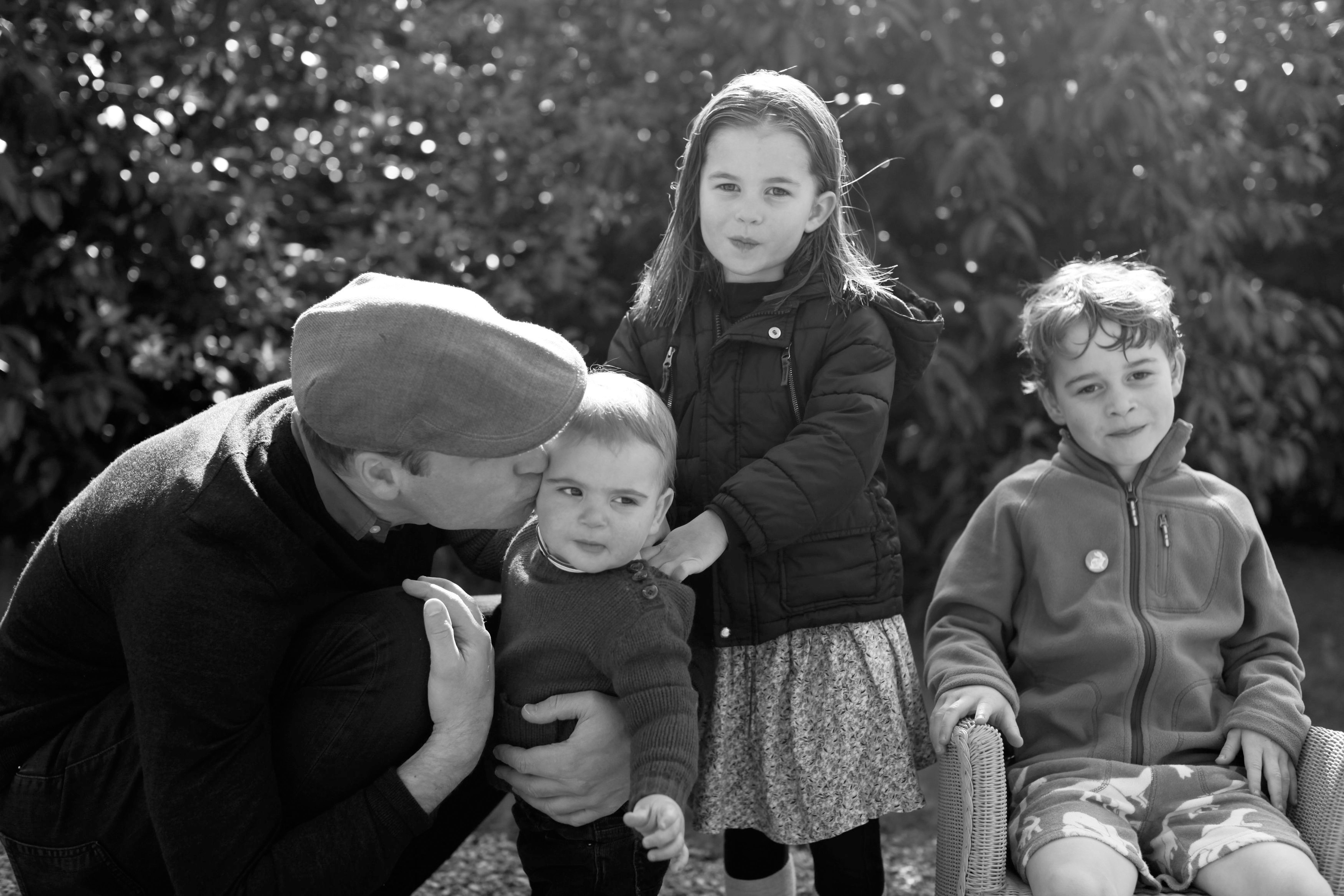 A picture taken by Kate Middleton of Prince William and their three children, Princes George, Louis, and Princess Charlotte, and released by Kensington Palace on December 25, 2019. | Source: Getty Images.