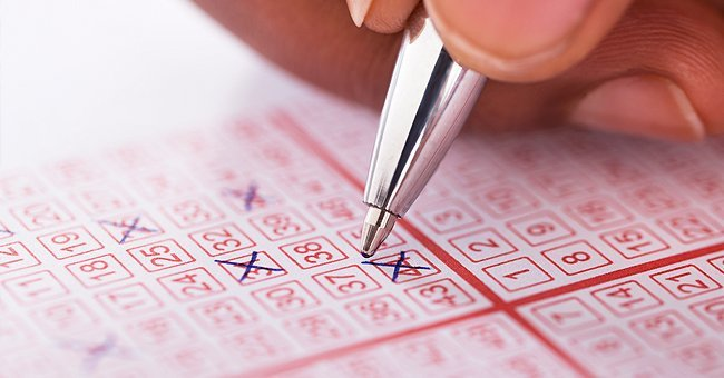 A person filling out lottery tickets. | Source: Shutterstock
