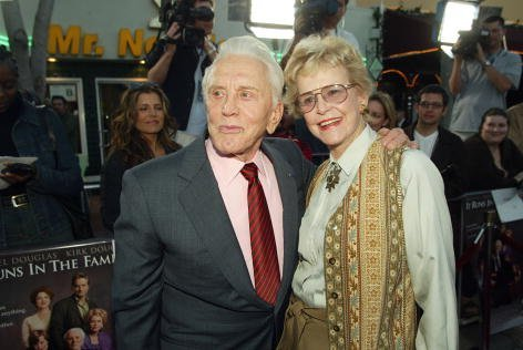 "Kirk Douglas (L) poses with actress and ex-wife Diana Douglas at the premiere of ""It Runs In The Family"" at the Bruin Theater on April 7, 2003, in Los Angeles, California. 