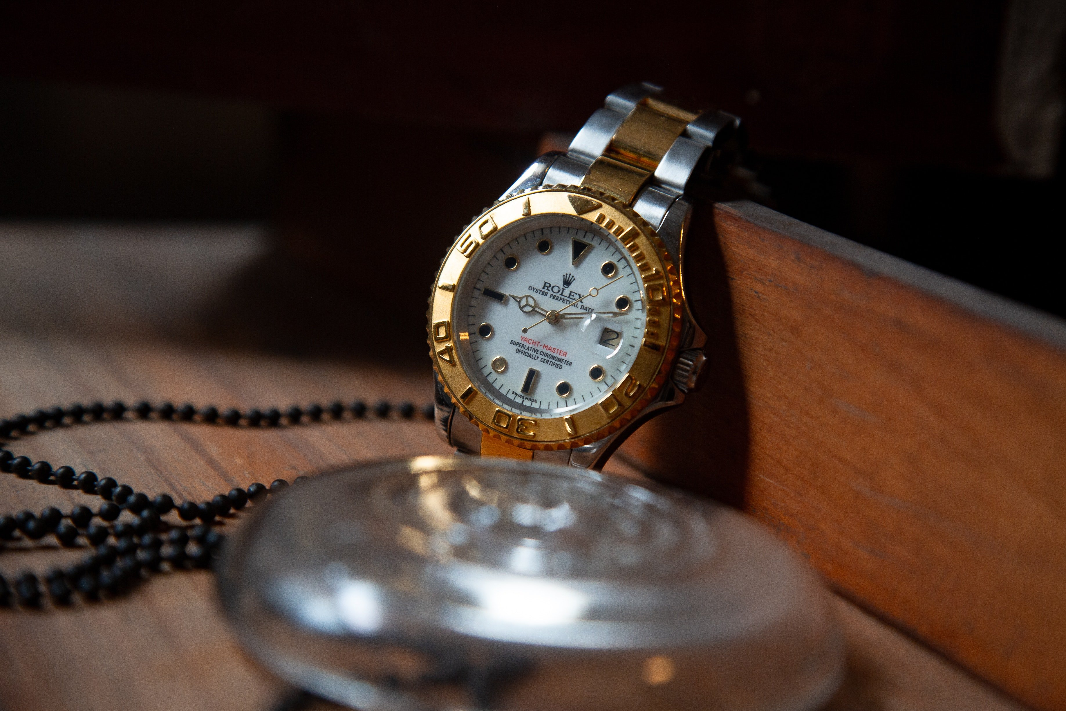 A vintage Rolex was nicely seated inside the wooden box   Source: Pexels