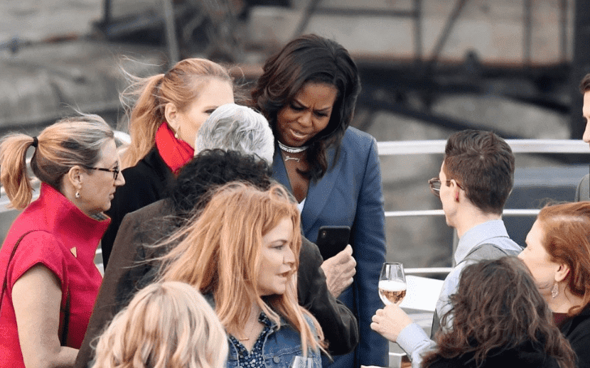 Former First Lady Michelle Obama on the Ducasse Sur Seine while the Notre Dame Cathedral was on fire | Photo: TMZ