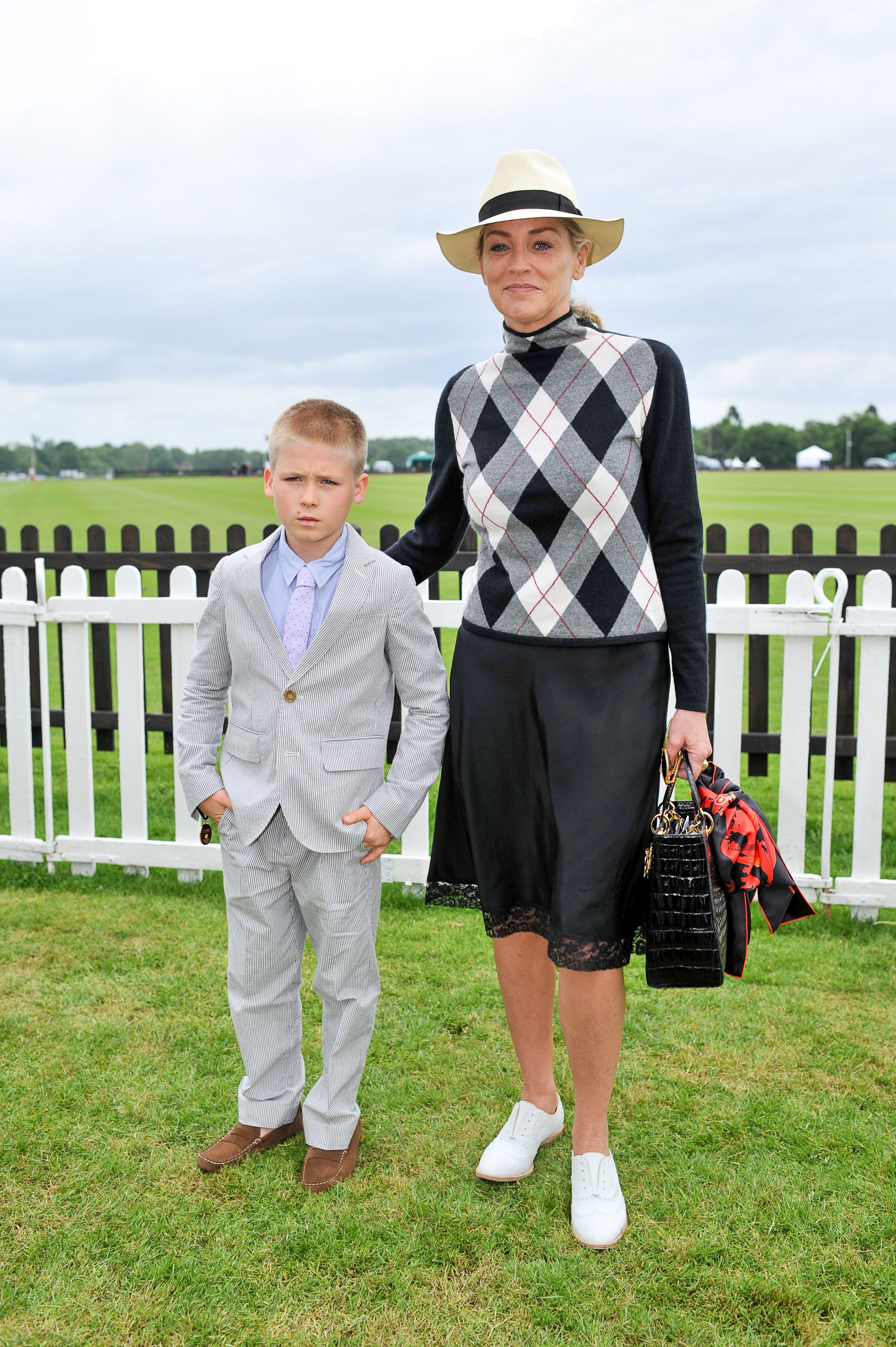 Sharon Stone and son Roan at the Cartier Queen's Cup final in 2013 in Egham, England | Source: Getty Images