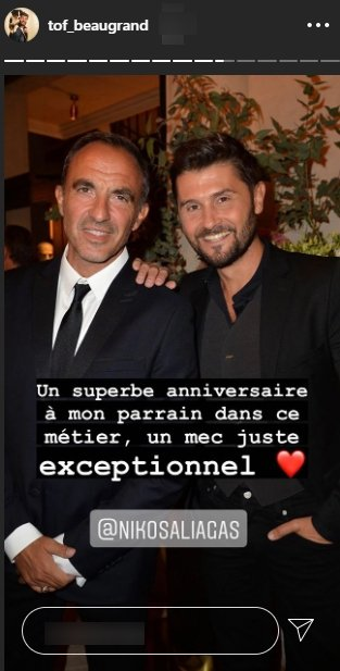 Christophe Beaugrand pose auprès de Nikos Aliagas | Source : Getty Images