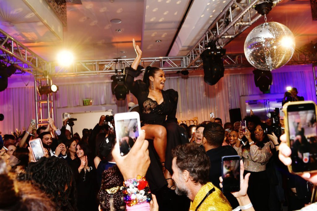"""Tiffany Haddish is raised in the air during her """"Black Mitzvah"""" on December 3, 2019. 