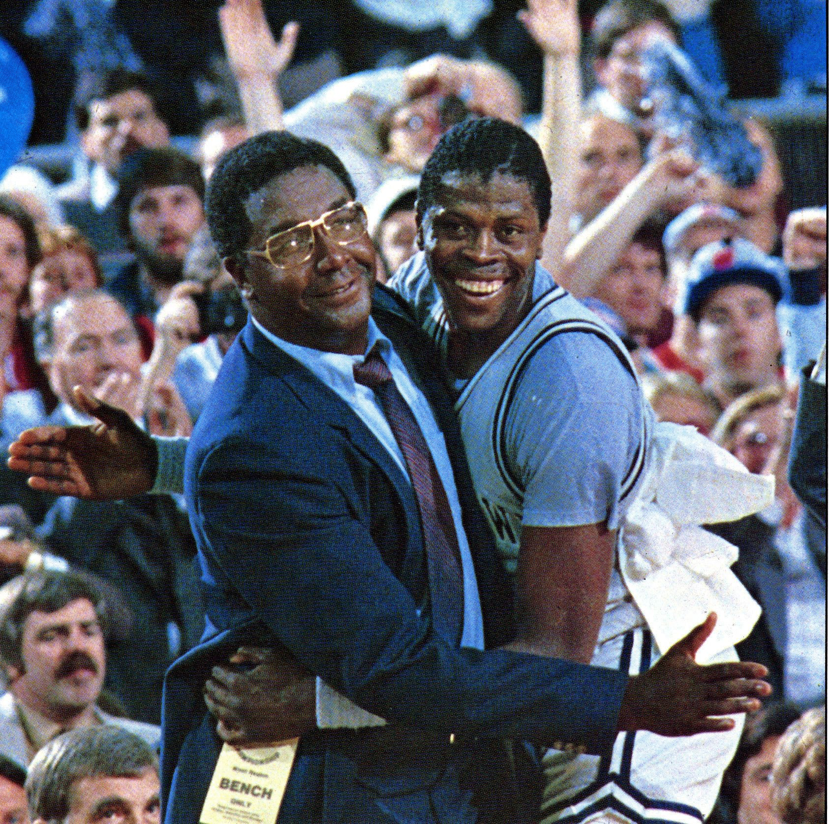 Patrick Ewing and late John Thompson pose for a photo during a game at McDonough Arena in Washington, D.C. | Photo: Getty Images.