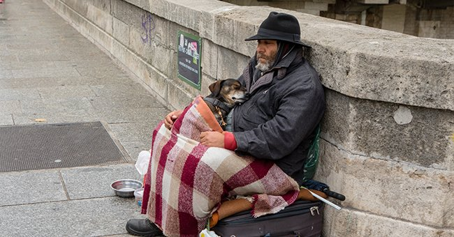 A homeless person and their dog.   Photo: Shutterstock