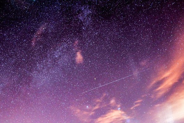 """A meteor streaks across the night sky during the Geminid meteor shower over Turkey's Van on December 13, 2017. """"Geminid"""" Meteor Shower or """"Shooting Stars"""" in public language was visible from Turkey's Van province 