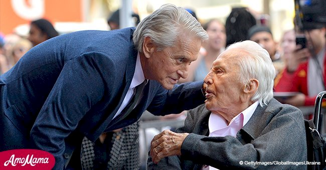 Michael Douglas kisses proud father Kirk at his Walk of Fame star ceremony