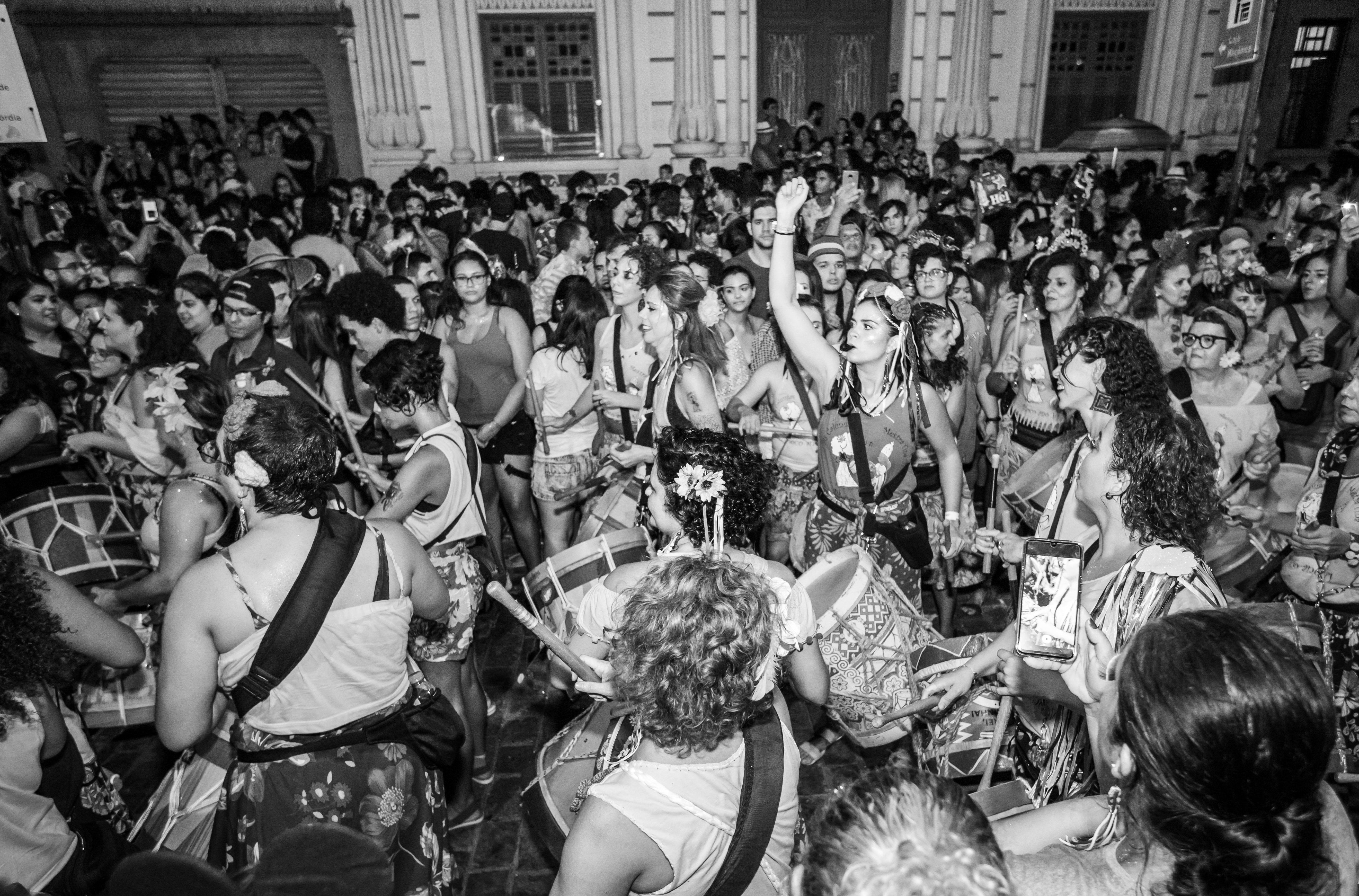 Black and white image of a house party.   Pexels/ alexandre saraiva carniato