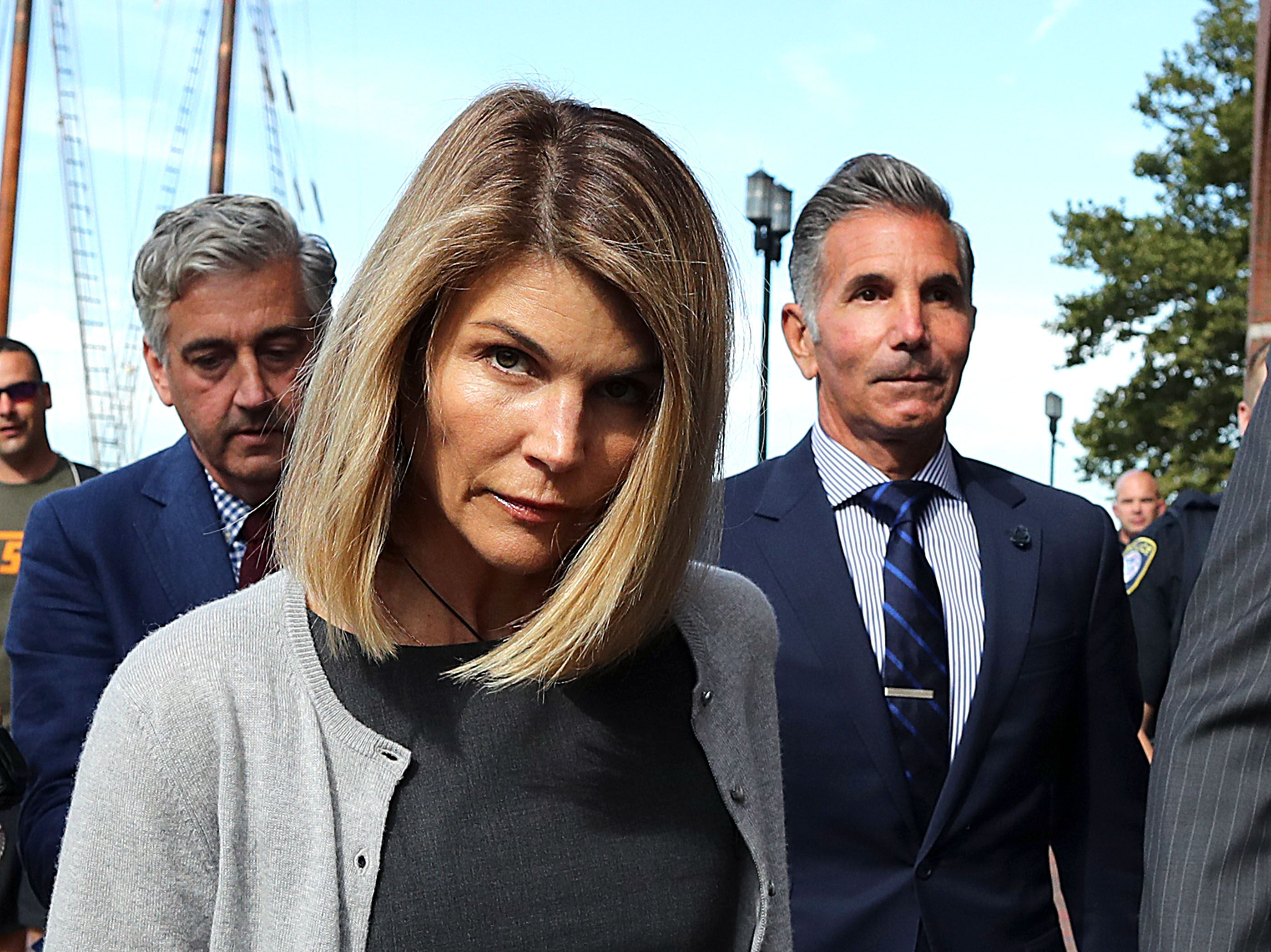 Lori Loughlin and her husband Mossimo Giannulli, right, leave the John Joseph Moakley United States Courthouse in Boston | Photo: Getty Images