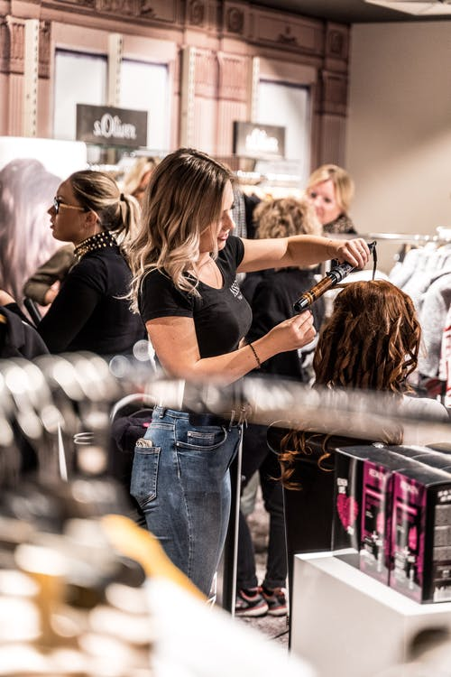 A photo of a woman at the salon with the hairdresser.   Photo: Pexels