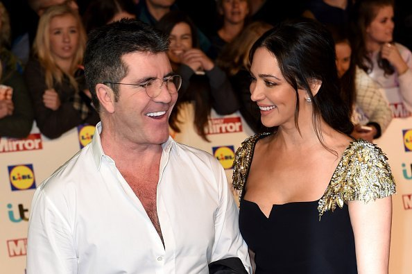 Simon Cowell and Lauren Silverman attend the Pride of Britain awards at The Grosvenor House Hotel on October 6, 2014, in London, England. | Source: Getty Images.