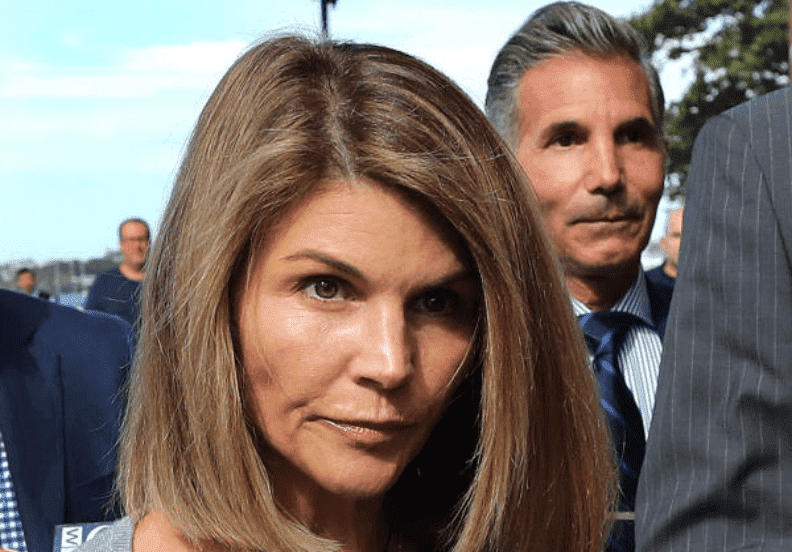 Lori Loughlin and her husband, Mossimo Giannulli are swarmed by press as they leave the John Joseph Moakley United States Courthouse, on Aug. 27, 2019, Boston | Source: John Tlumacki/The Boston Globe via Getty Images