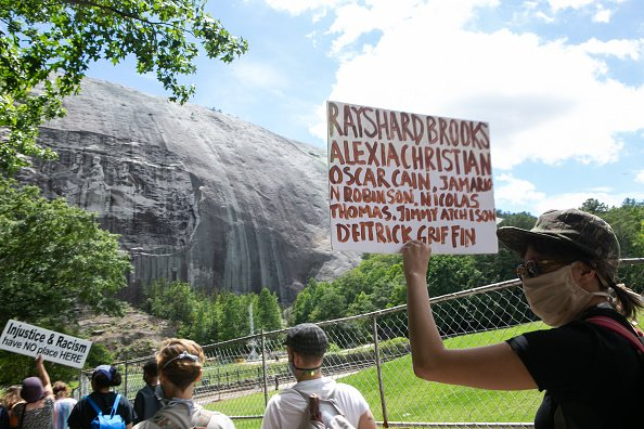Black Lives Matter protesters march towards the Confederate carving in Stone Mountain Park on June 16, 2020 in Stone Mountain, Georgia.   Photo: Getty Images