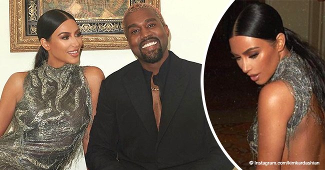 Kim Kardashian stuns the crowd in backless Versace dress on date night with Kanye