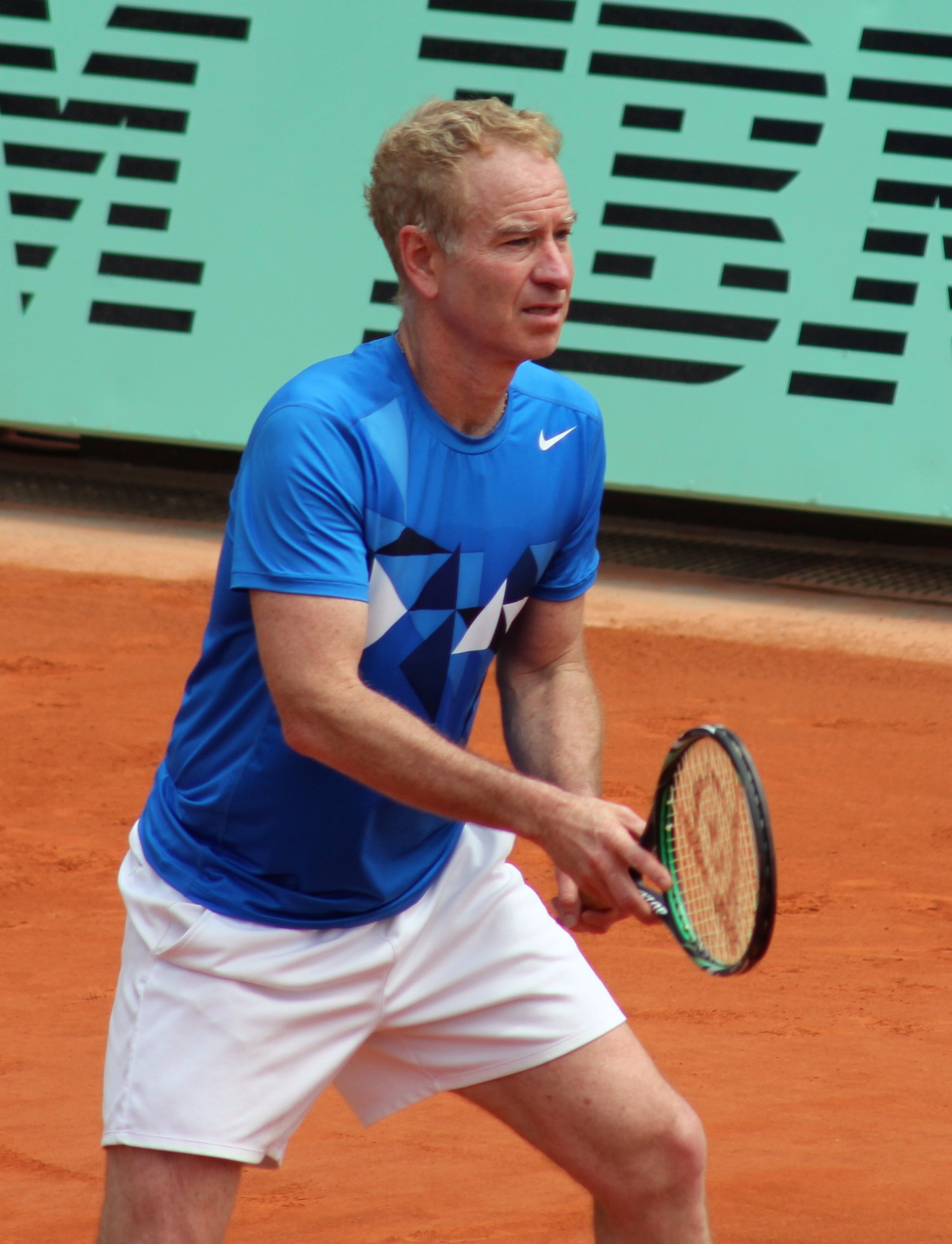 John McEnroe at the 2012 French Open – Legends Over 45 Doubles | Photo By Pruneau - Own work, CC BY-SA 3.0, Wikimedia Commons Images