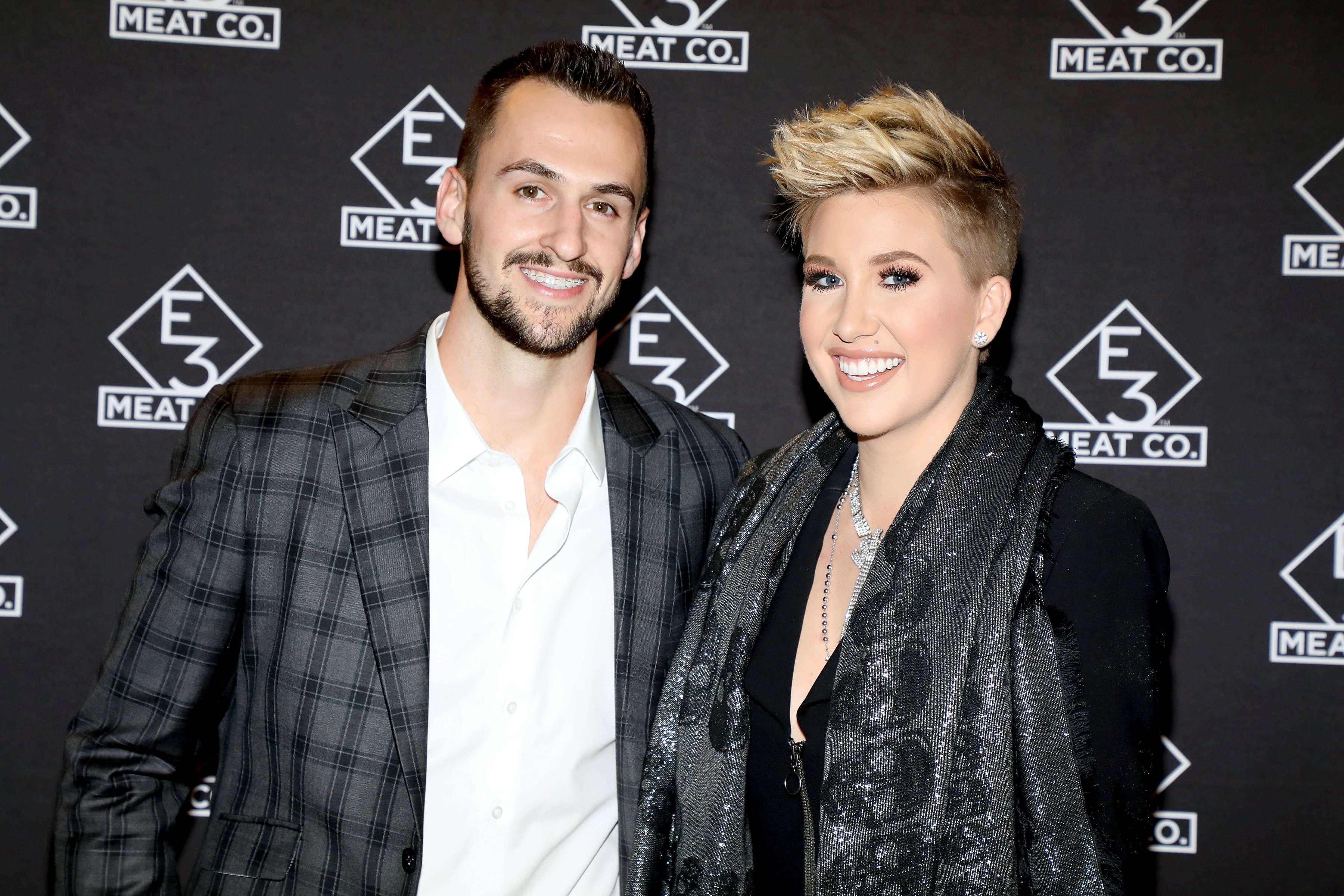 Nic Kerdiles and Savannah Chrisley attend the grand opening of E3 Chophouse Nashville on November 20, 2019, in Nashville, Tennessee.   Source: Getty Images.