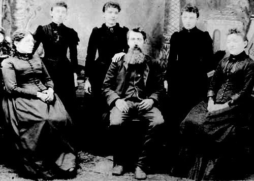 A portrait of Caroline Ingalls, Carrie Ingalls, Laura Ingalls, Charles Ingalls, Grace Ingalls and Mary Ingalls.   Source: Wikimedia Commons