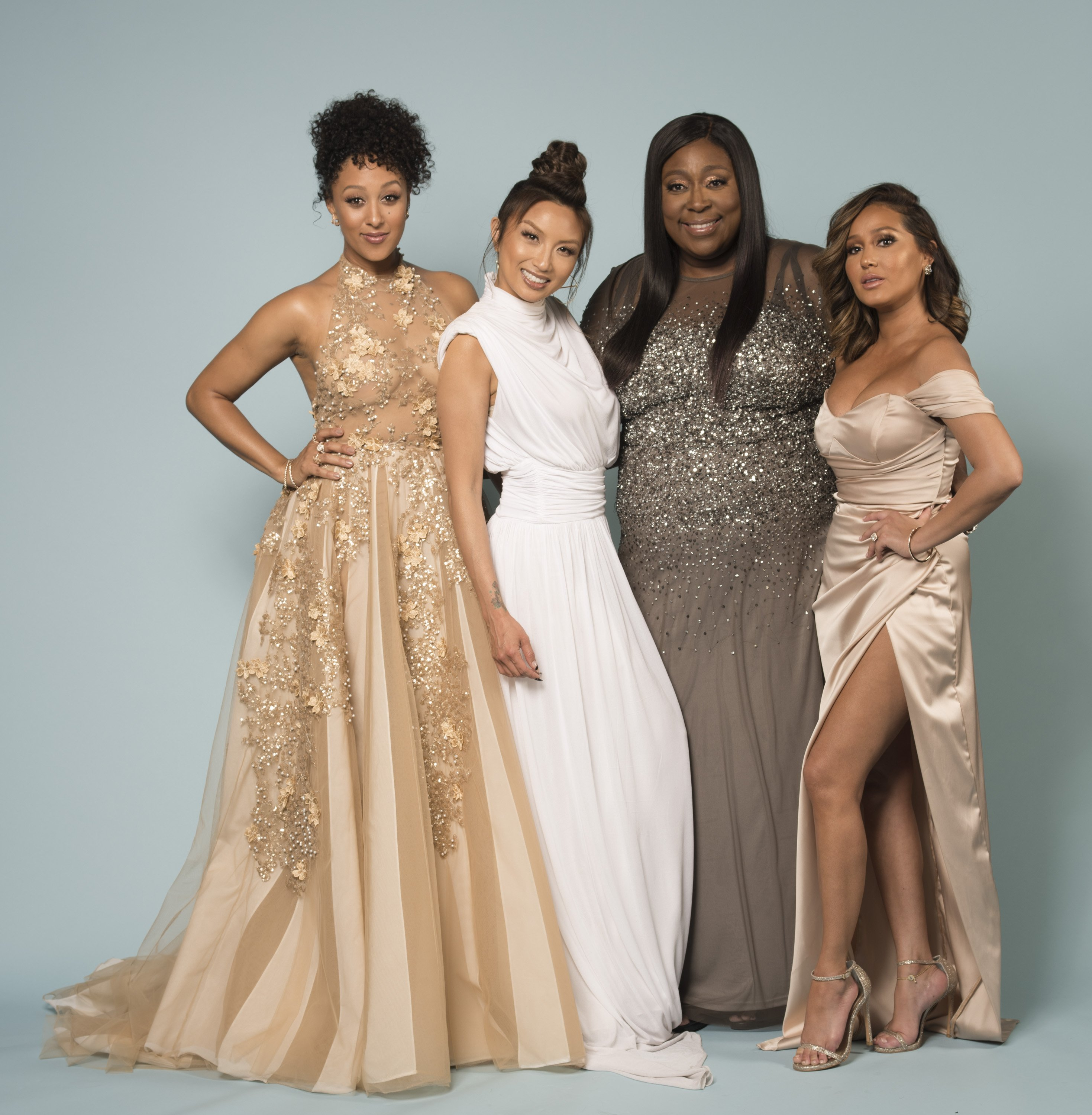 "Tamera Mowry, Jeannie Mai, Loni Love, and Adrienne Bailon pose for a portrait at ""Portraits by The Artists Project Sponsored by Foster Grant on"" during the 44th Daytime Emmy Awards on April 30, 2017