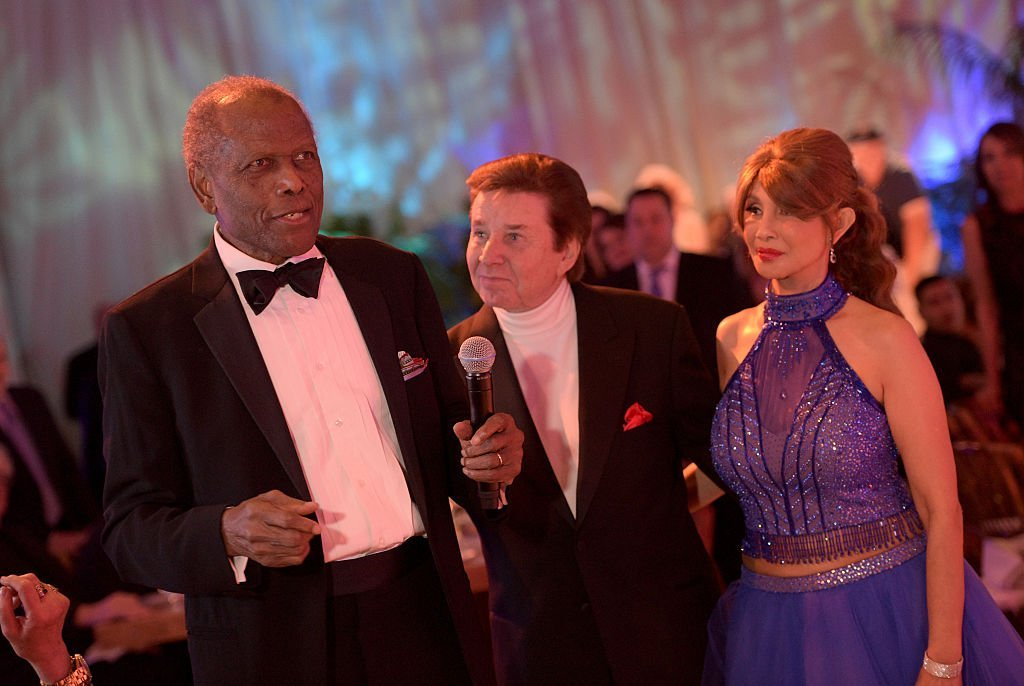 Sidney Poitier, singer Bobby Sherman, and Brigitte Sherman attend the Brigitte and Bobby Sherman Children's Foundation's 6th Annual Christmas Gala | Getty Images / Global Images Ukraine