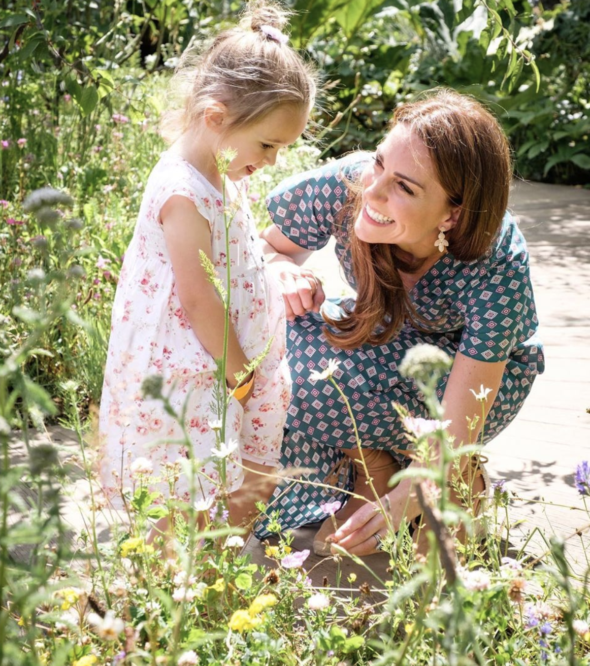 All smiles: Kate beams at a little girl in pink dress at her Back To Nature Garden. | Source: Instagram/kensigtonroyal