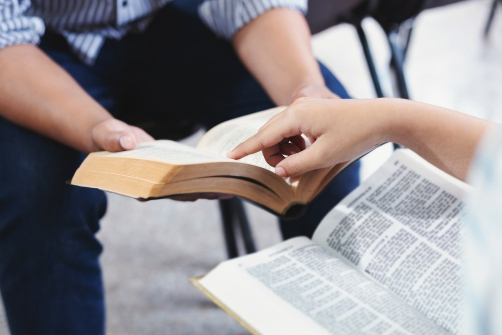 Holy Bible study reading together in Sunday school  | Getty Images