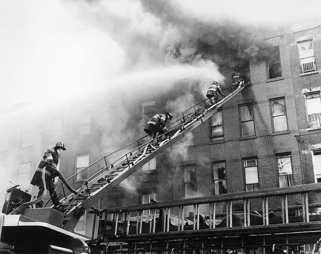 Firefighters rescuing a burnt down house in Brooklyn, new York.   Source: Getty Images