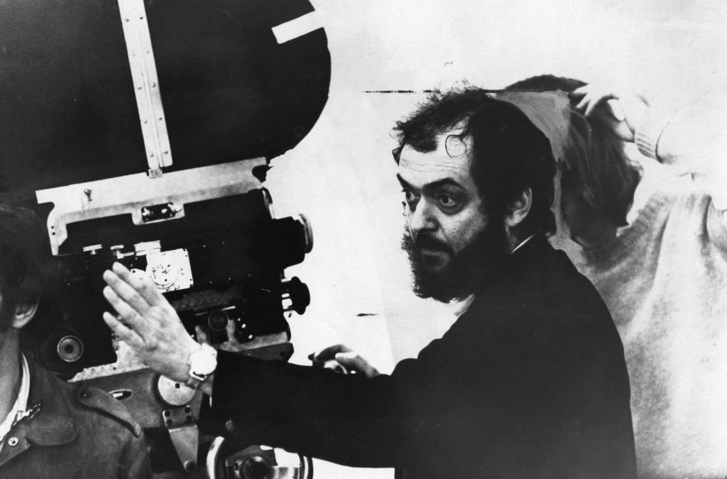 American film director Stanley Kubrick looking through a movie camera | Getty Images