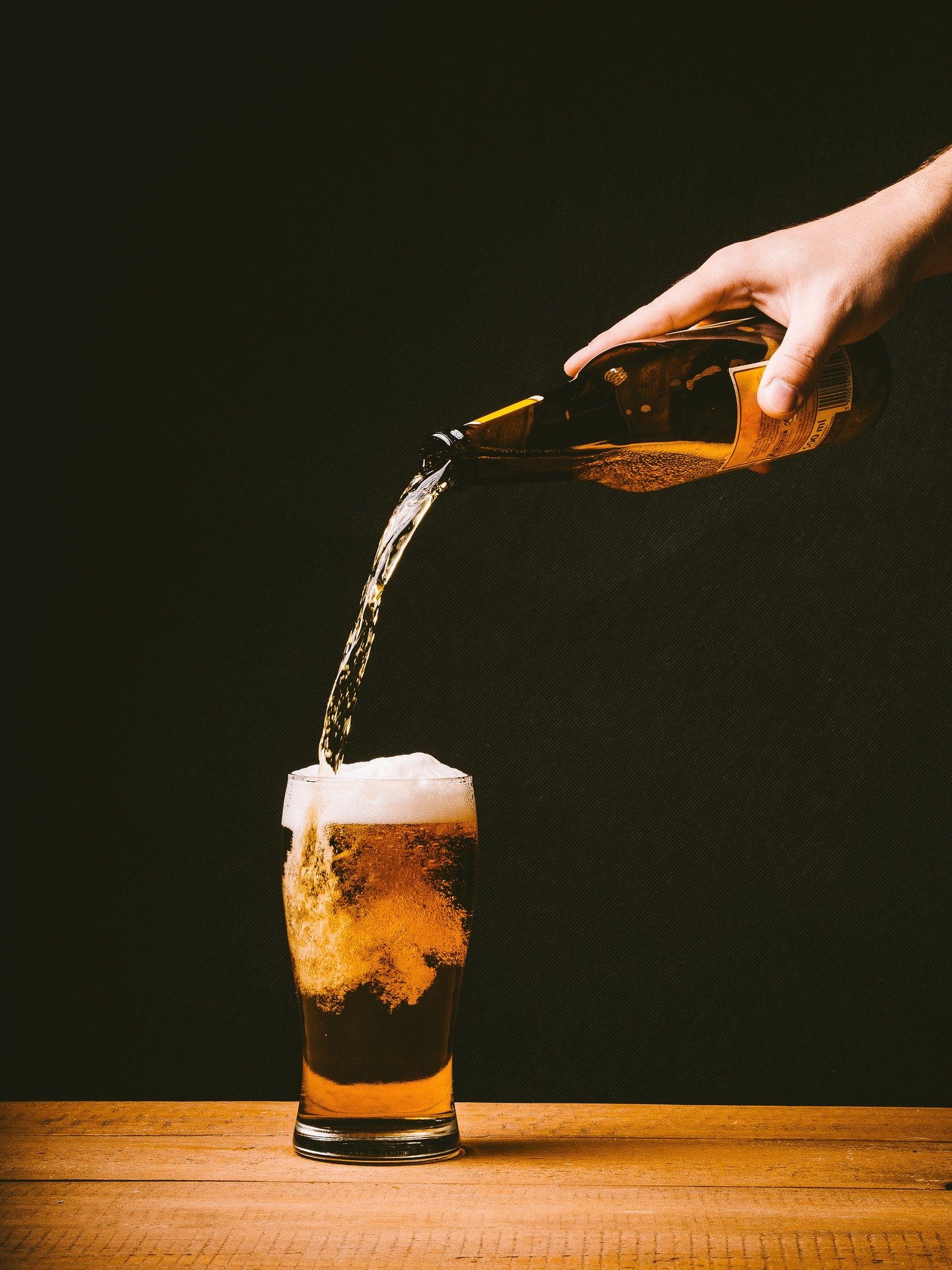 Pictured - A man pouring a glass of beer   Source: Pixabay