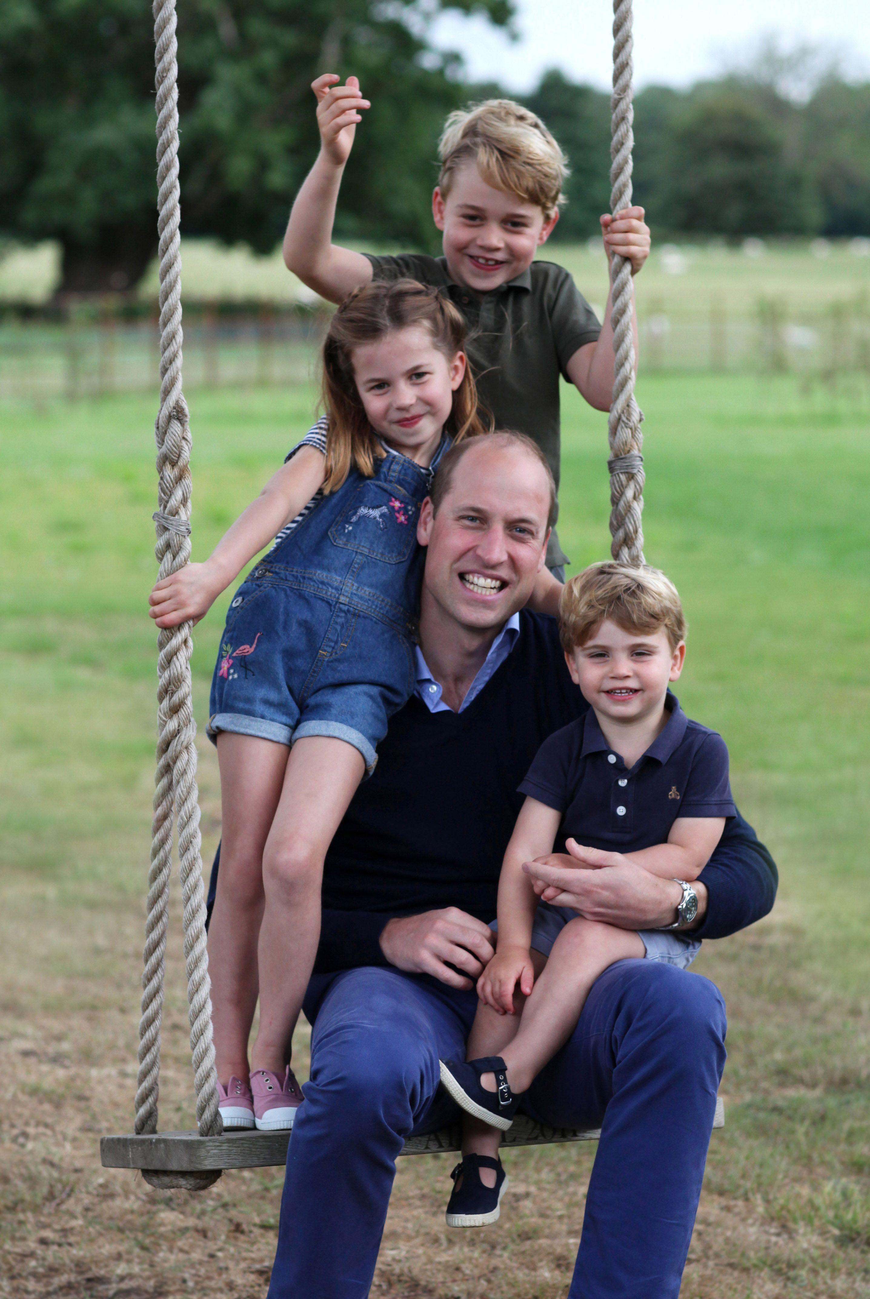 Prince William on a swing with Prince George, Princess Charlotte, and Prince Louis to mark both his birthday and Fathers Day on June 20, 2020, at Kensington Palace | Photo: Duchess Kate/Kensington Palace/Getty Images