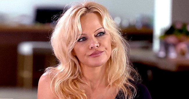 Pamela Anderson Flaunts Curvy Hips and Endless Legs While Straddling Bench in a Mini Dress