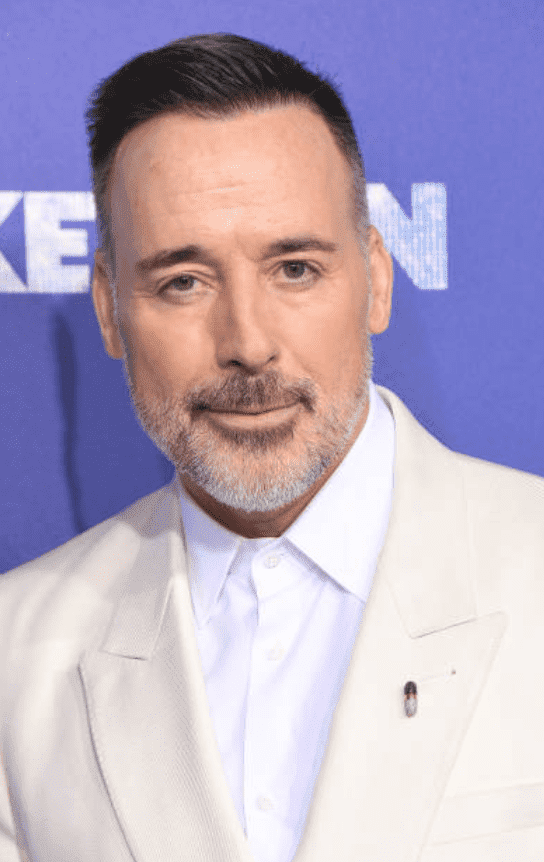 "David Furnish poses in a monochrome suit at the premiere of ""Rocketman,"" at Alice Tully Hall, on May 29, 2019, New York 