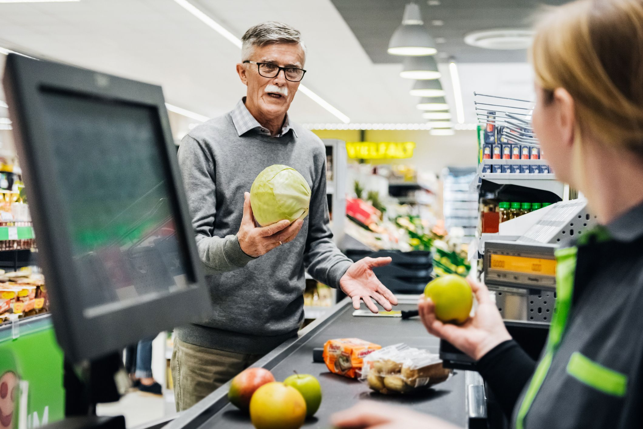A man holding a melon at the checkout in his local supermarket.   Source: Shutterstock